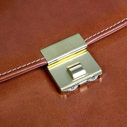 Cierre dorado del maletín con código anti-robo
